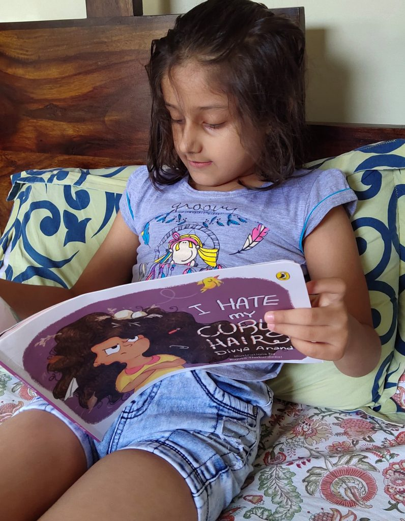 Reading the wonderful book, I hate my curly hair!